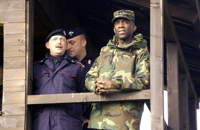 US Army (USA) Lieutenant General (LGEN) William E. Ward, Commander of Stabilization Force (COMSFOR), looks on as Colonel (COL) Antonio Colacicco, Commander of Multinational Specialized Unit (MSU), left, brief him on upcoming events during an MSU Civil Disturbance Demonstration on Camp Butmir in Sarajevo, Bosnia and Herzegovina, in support of Operation JOINT FORGE