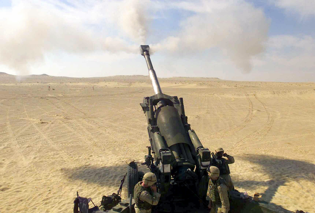 A US Marine Corps (USMC) M198 155mm Towed Howitzer, assigned to Fox/Battery, Battalion Landing Team (BLT), 2nd Battalion, 2nd Marines, 24th Marine Expeditionary Unit (MEU), Special Operations Capable (SOC), is fired down range during a training exercise conducted in the US Central Commands (USCENTCOM) Area of Responsibility (AOR), to support Operation ENDURING FREEDOM