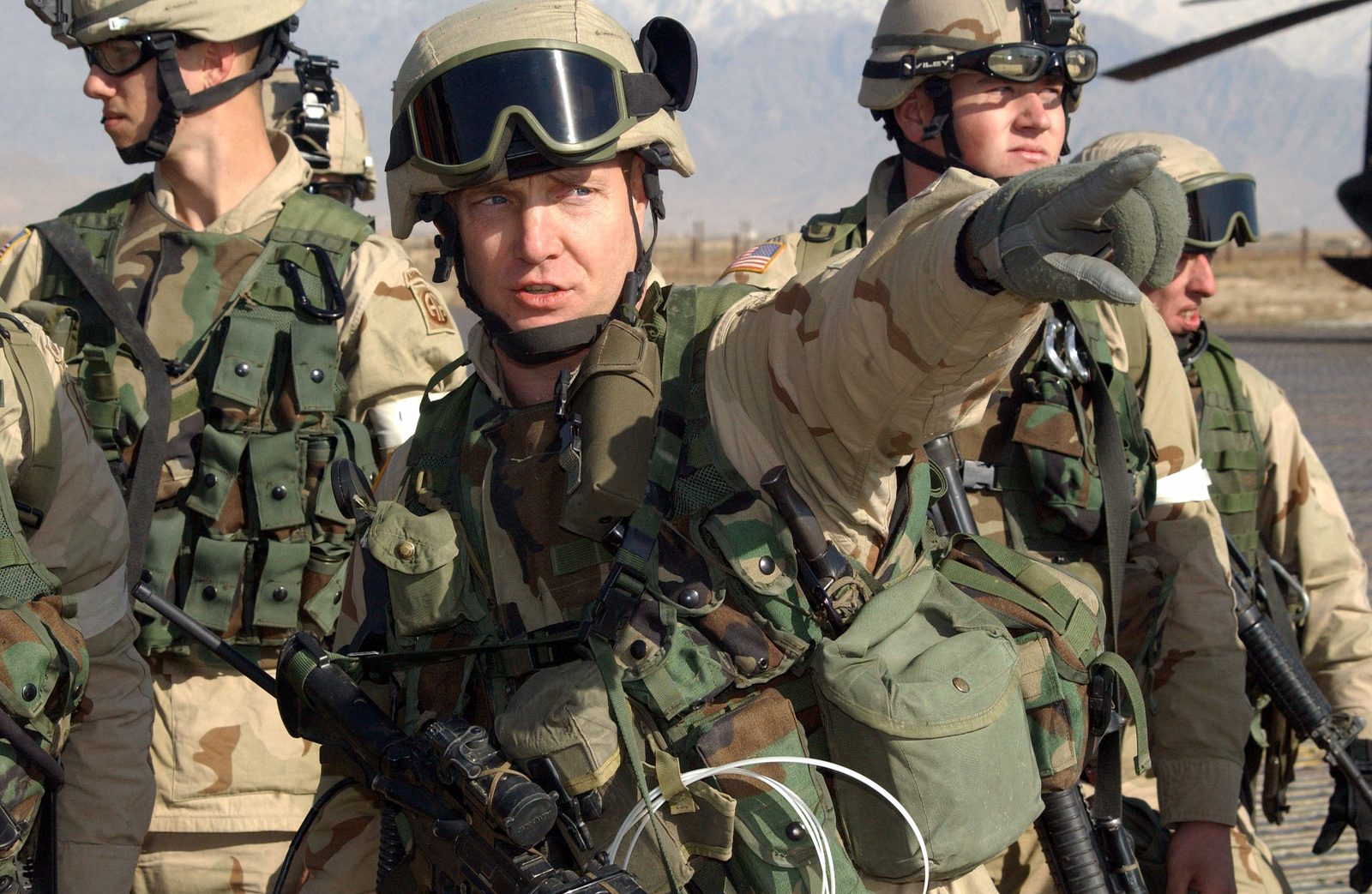 """First Sergeant (1SG) Bruce Meyers and his men, assigned to """"C"""" Company, 2nd Battalion, 504th Parachute Infantry Regiment (PIR), 82nd Airborne Division, armed with 5.56 mm M-4 carbines, conduct a Quick Reaction Force (QRF) mission at Bagram Airfield in Kabul, in support of Operation ENDURING FREEDOM"""