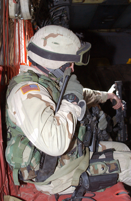 """First Sergeant (1SG) Bruce Meyers, assigned to """"C"""" Company, 2nd Battalion, 504th Parachute Infantry Regiment (PIR), 82nd Airborne Division, armed with a 5.56 mm M-4 carbine and an 9mm Beretta M9 sidearm, conducts a Quick Reaction Force (QRF) mission at Bagram Airfield in Kabul, in support of Operation ENDURING FREEDOM"""