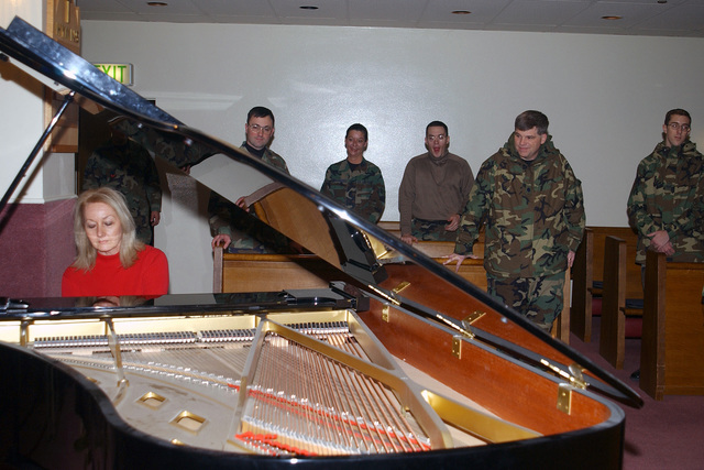 Mrs. Kathy Wooley, wife of the 3rd Air Force (AF) Commander, entertains members of the 469th Air Base Group (ABG) with a rendition at a Grand Piano during her visit to the Chapel at Rhein-Main Air Base (AB)