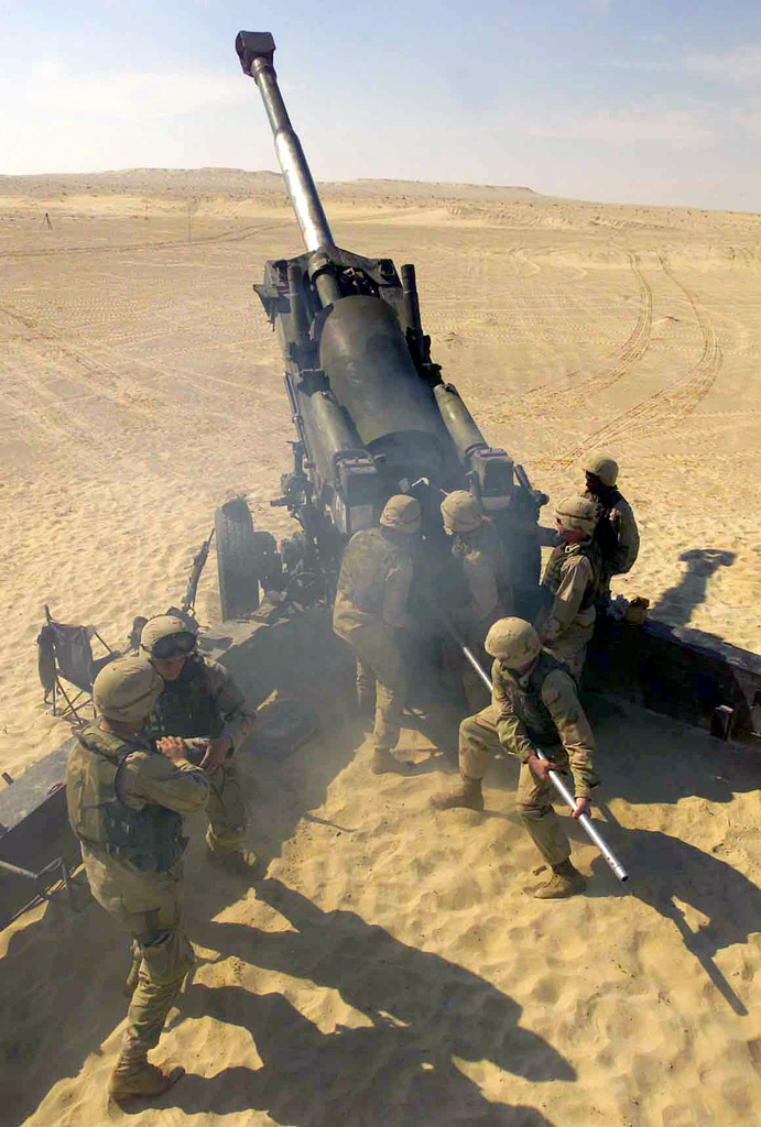 US Marine Corps (USMC) Marines assigned to Fox/Battery, Battalion Landing Team (BLT), 2nd Battalion, 2nd Marines, 24th Marine Expeditionary Unit (MEU), Special Operations Capable (SOC), prepare to fire their M198 155mm Towed Howitzer, during Exercise Iron Magic 03, a training exercise conducted in the US Central Commands (USCENTCOM) Area of Responsibility (AOR), to support Operation ENDURING FREEDOM