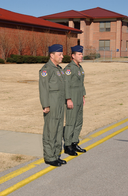 US Air Force (USAF) Colonel (COL) Paul D. Brown, Jr. (left), Commander, and COL Robert F. Reinhardt, Vice-Commander, 117th Air Refueling Wing (ARW) await the arrival the Air Mobility Command (AMC) and US Transportation Command (USTRANSCOM) commander