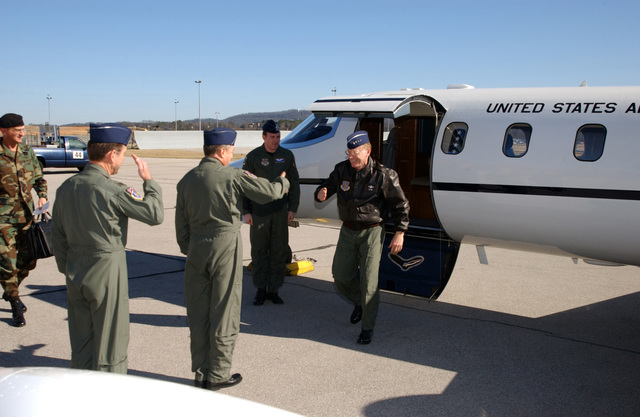 US Air Force (USAF) General (GEN) John W. Handy, Commander, Air Mobility Command (AMC) and US Transportation Command (USTRANSCOM), visits the 117th Air Refueling Wing (ARW), Alabama Air National Guard (ANG), Birmingham, Alabama (AL). From left to right in foreground, USAF Colonel (COL) Robert F. Reinhardt, Vice-Commander, 117th ARW and USAF COL Paul D. Brown, Commander, 117th ARW, greet GEN Handy