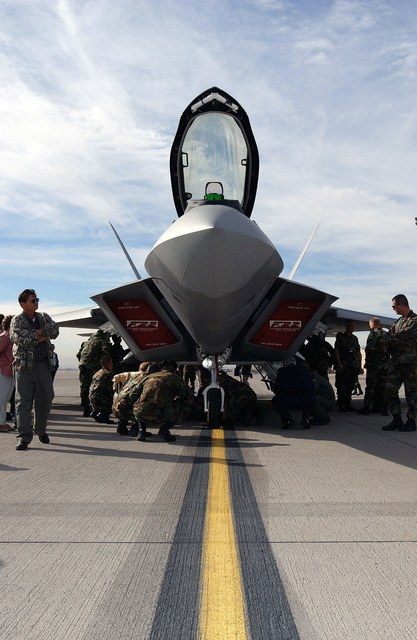 Civilian spectators and US Air Force (USAF) personnel take a close look at the first USAF F/A-22 Raptor to arrive at Nellis Air Force Base (AFB), Nevada (NV)
