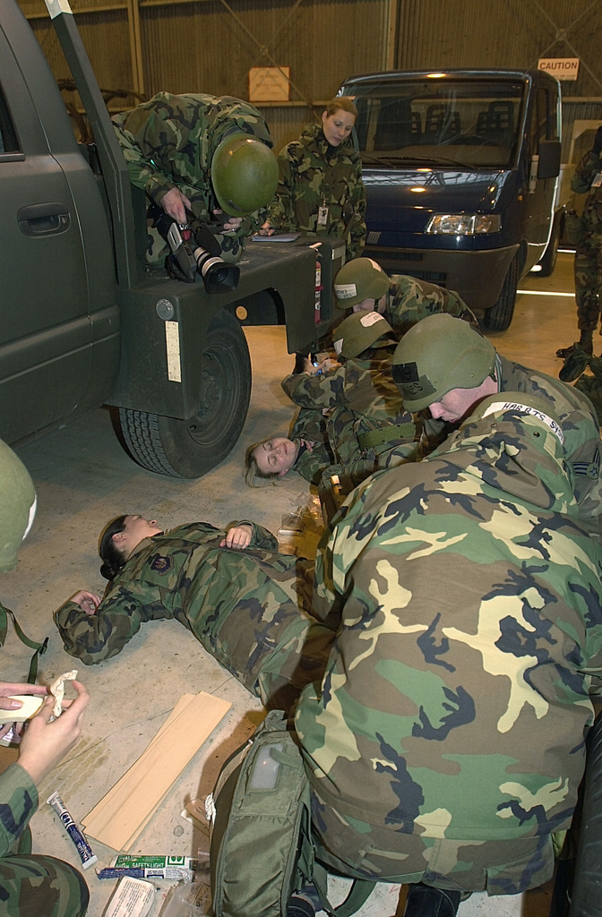 US Air Force (USAF) Airmen from the 31st Aircraft Maintenance Squadron (AMXS), provide self-aid buddy care to injured personnel after a simulated conventional attack during fracture during the LOCAL SALTY NATION (LSN) exercise. The LSN will prepare members of the 31st Fighter Wing (FW) for an upcoming Tactical Evaluation