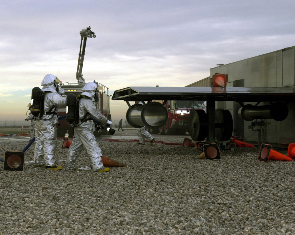 US Air Force (USAF) Airmen of the 31st Civil Engineer Squadron (CES) fire fighters, in Joint Firefighters Integrated Response Ensemble (JFIRE), extinguish flames on a simulated damaged aircraft, during a LOCAL SALTY NATION (LSN) exercise, simulating the Southlands invading the Northlands, in preparation for an upcoming Tactical Evaluation