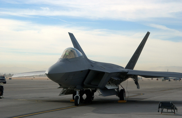 US Air Force (USAF) personnel chock and ground the first USAF F/A-22 Raptor to arrive at Nellis Air Force Base (AFB), Nevada (NV)