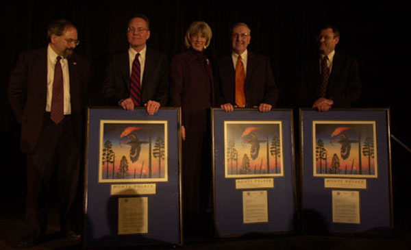 Agriculture Under Secretary for Natural Resources and Environment, Mark Rey, far left, and Interior Secretary Gale Norton, third from left, joining honorees at fire plan conference in New Orleans, Louisiana. Department of Interior and Department of Agriculture-sponsored National Fire Plan Award winners were recognized for efforts to protect public lands and wildlife