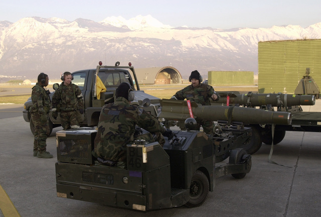 US Air Force (USAF) Aircraft Armament Journeymen with the 31st Aircraft Maintenance Squadron (AMXS), use an MJ-1 Lift Truck, a.k.a. Jammer, to move a GBU-12, sans CCG MAU-169 guidance system, from the trailer as they simulate replenishment of munition during the LOCAL SALTY NATION (LSN) exercise. The LSN will prepare 31st Fighter Wing (FW) members for an upcoming Tactical Evaluation
