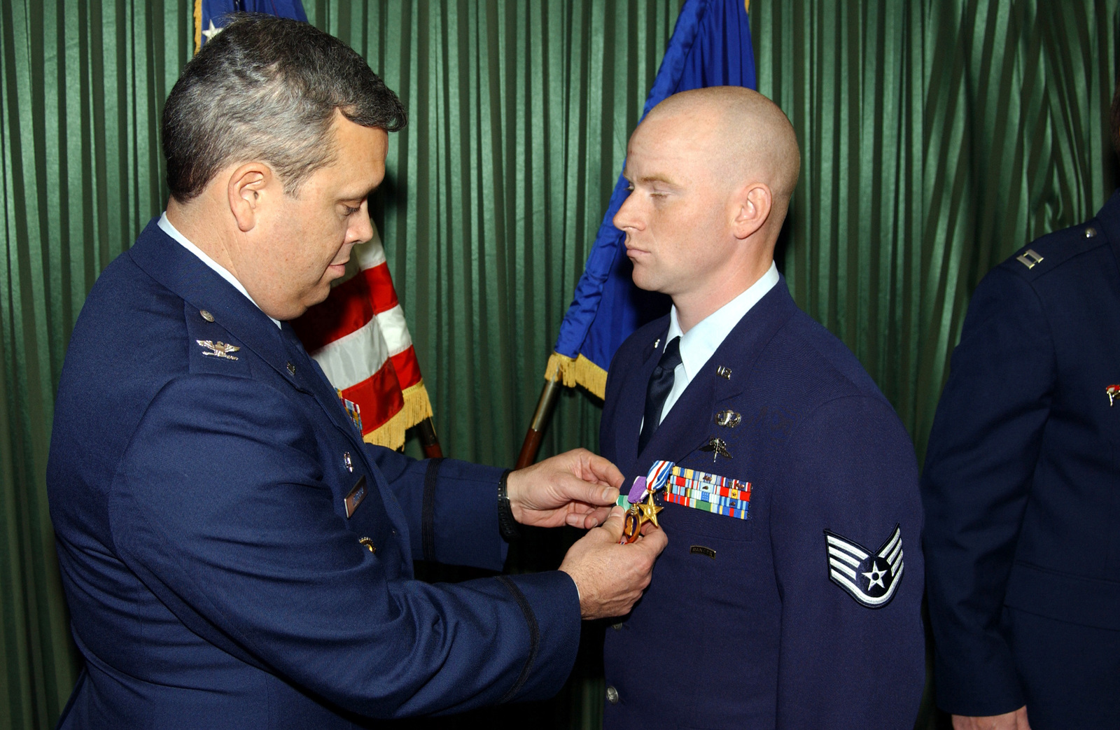 US Air Force (USAF) Colonel (COL) Michael A Longoria (left), Commander, 18th Air Support Operations Group (ASOG), Pope Air Force Base (AFB), North Carolina (NC), pins the Bronze Star on USAF STAFF Sergeant (SSGT) Kevin D Vance, 17th Air Support Operations Squadron (ASOS), Hunter Army Airfield (AAF), Georgia (GA). They awards ceremony was held at the Hunter Club on the base