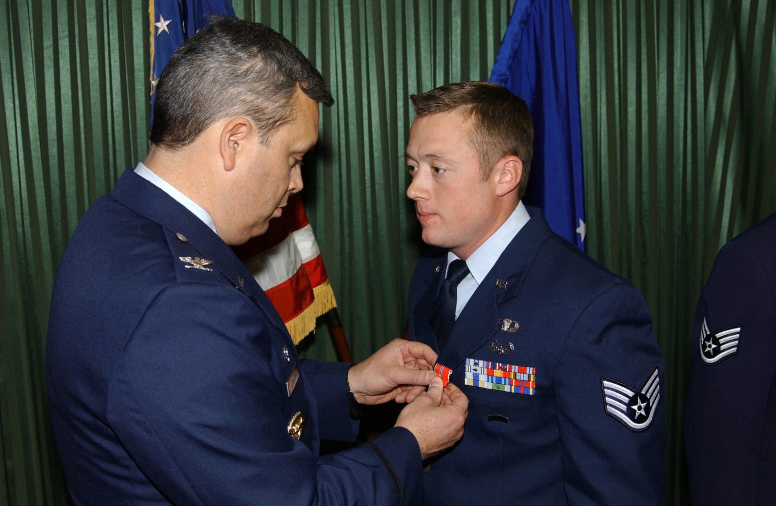 US Air Force (USAF) Colonel (COL) Michael A Longoria (left), Commander, 18th Air Support Operations Group (ASOG), Pope Air Force Base (AFB), North Carolina (NC), pins the Bronze Star on USAF STAFF Sergeant (SSGT) Abel S. Martens, 17th Air Support Operations Squadron (ASOS), Hunter Army Airfield (AAF), Georgia (GA). They awards ceremony was held at the Hunter Club on the base