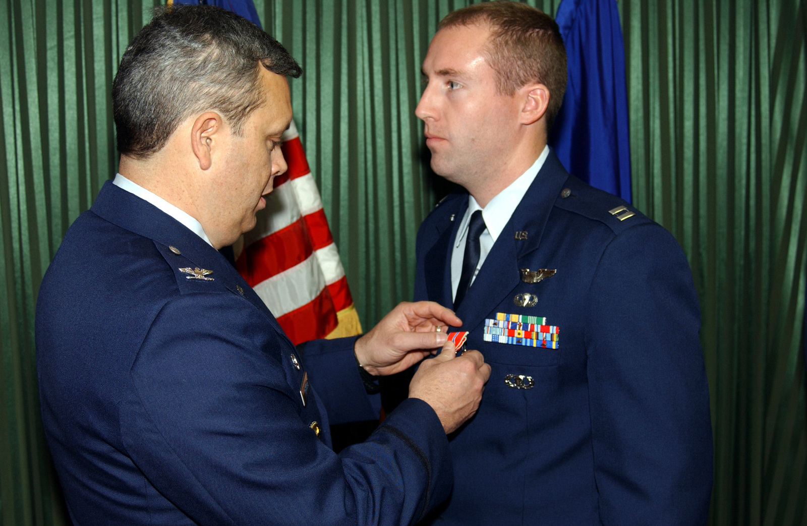 US Air Force (USAF) Colonel (COL) Michael A Longoria (left), Commander, 18th Air Support Operations Group (ASOG), Pope Air Force Base (AFB), North Carolina (NC), pins the Bronze Star on USAF Captain (CAPT) David A Ferguson, 17th Air Support Operations Squadron (ASOS), Hunter Army Airfield (AAF), Georgia (GA). They awards ceremony was held at the Hunter Club on the base