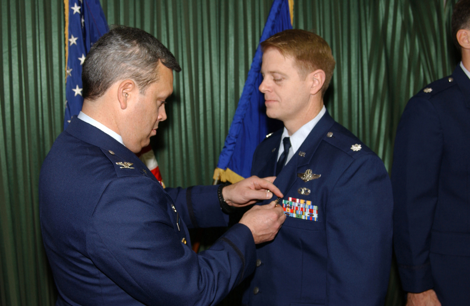 US Air Force (USAF) Colonel (COL) Michael A Longoria (left), Commander, 18th Air Support Operations Group (ASOG), Pope Air Force Base (AFB), North Carolina (NC), pins the Bronze Star on USAF Lieutenant Colonel (LCOL) Donald D Tharp, 17th Air Support Operations Squadron (ASOS), Hunter Army Airfield (AAF), Georgia (GA). They awards ceremony was held at the Hunter Club on the base