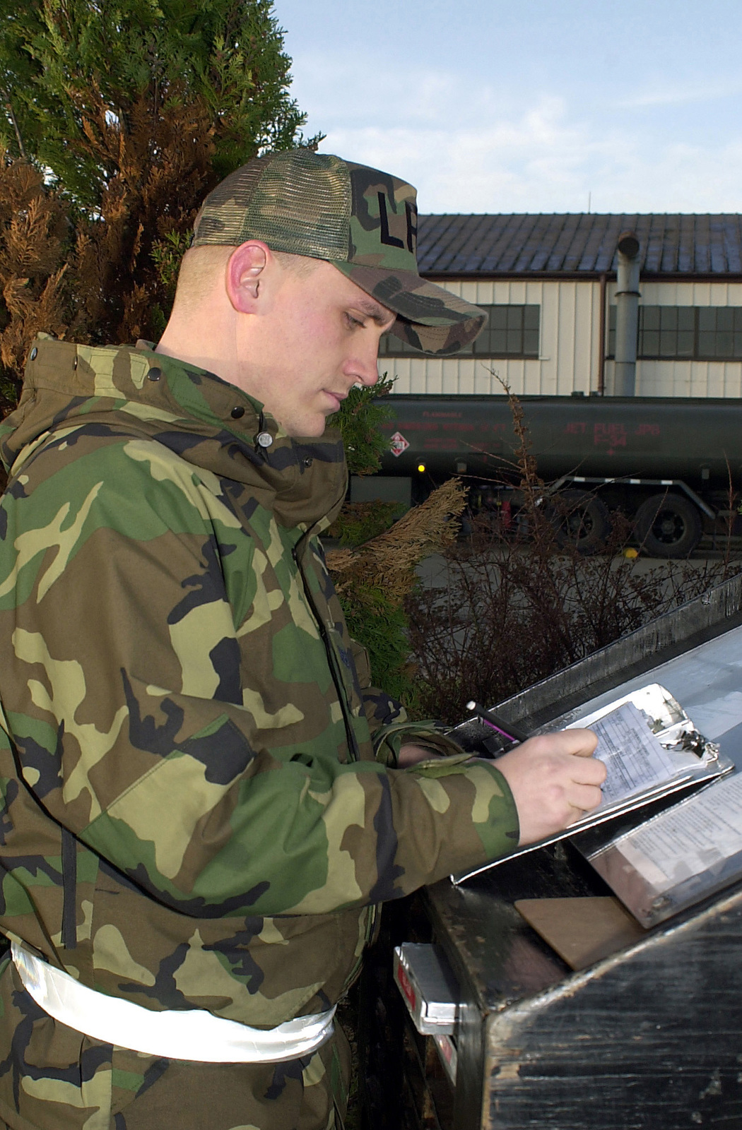 US Air Force (USAF) STAFF Sergeant (SSGT) Eric Dick, 100th Logistics Readiness Squadron (LRS), annotates fuel truck maintenance discrepancies at RAF Mildenhall, United Kingdom. The discrepancies are then reported to the Transportation Refueling Maintenance shop to schedule repairs