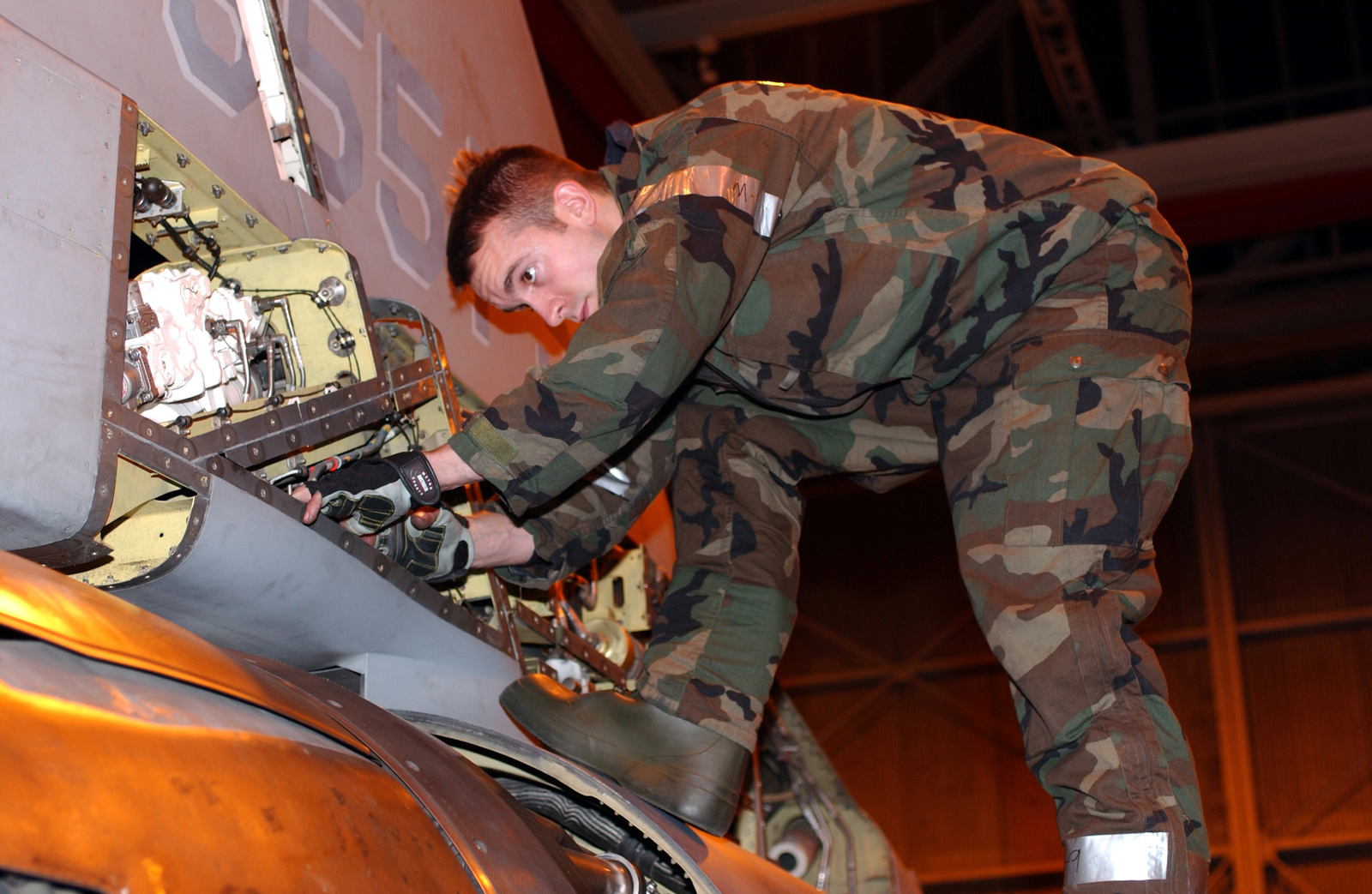 US Air Force (USAF) STAFF Sergeant (SSGT) Joseph Carrender, Phase Inspection Team Member, 31st Aircraft Maintenance Squadron (AMXS), performs routine maintenance on an F-16 Fighting Falcon, while in Mission-Oriented Protective Posture response level 2 (MOPP-2), during the LOCAL SALTY NATION exercise. The LSN prepares members of the 31st Fighter Wing (FW) for an upcoming Tactical Evaluation