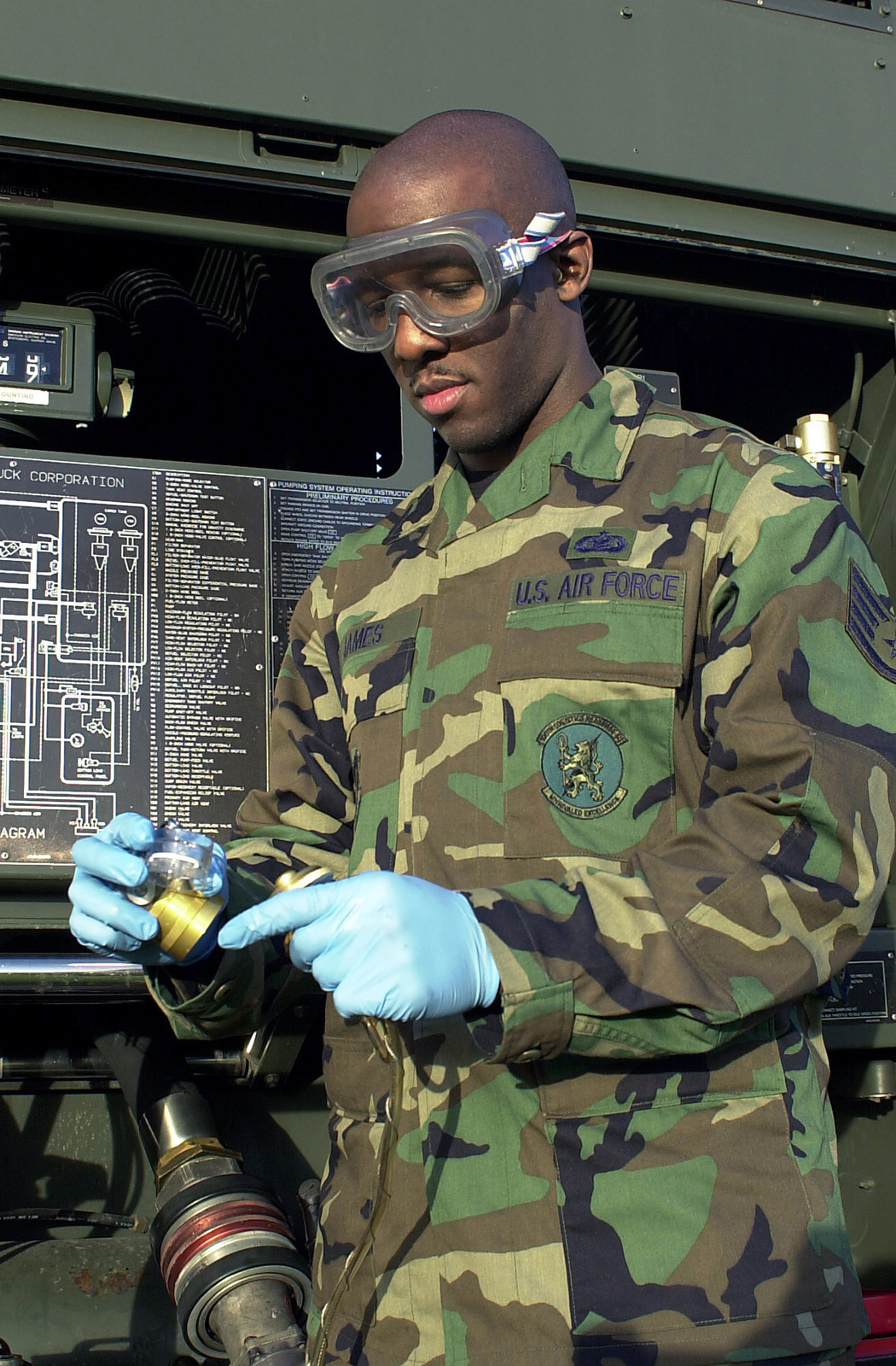US Air Force (USAF) STAFF Sergeant (SSGT) Rasmus O. James, 100th Logistics Readiness Squadron, prepares a Contamination Analysis filtering Unit, an in-line fuel sampler, for his fuel truck at RAF Mildenhall, United Kingdom. The Unit helps technicians check the fuel color and for particle assessment tests required to maintain fuel quality