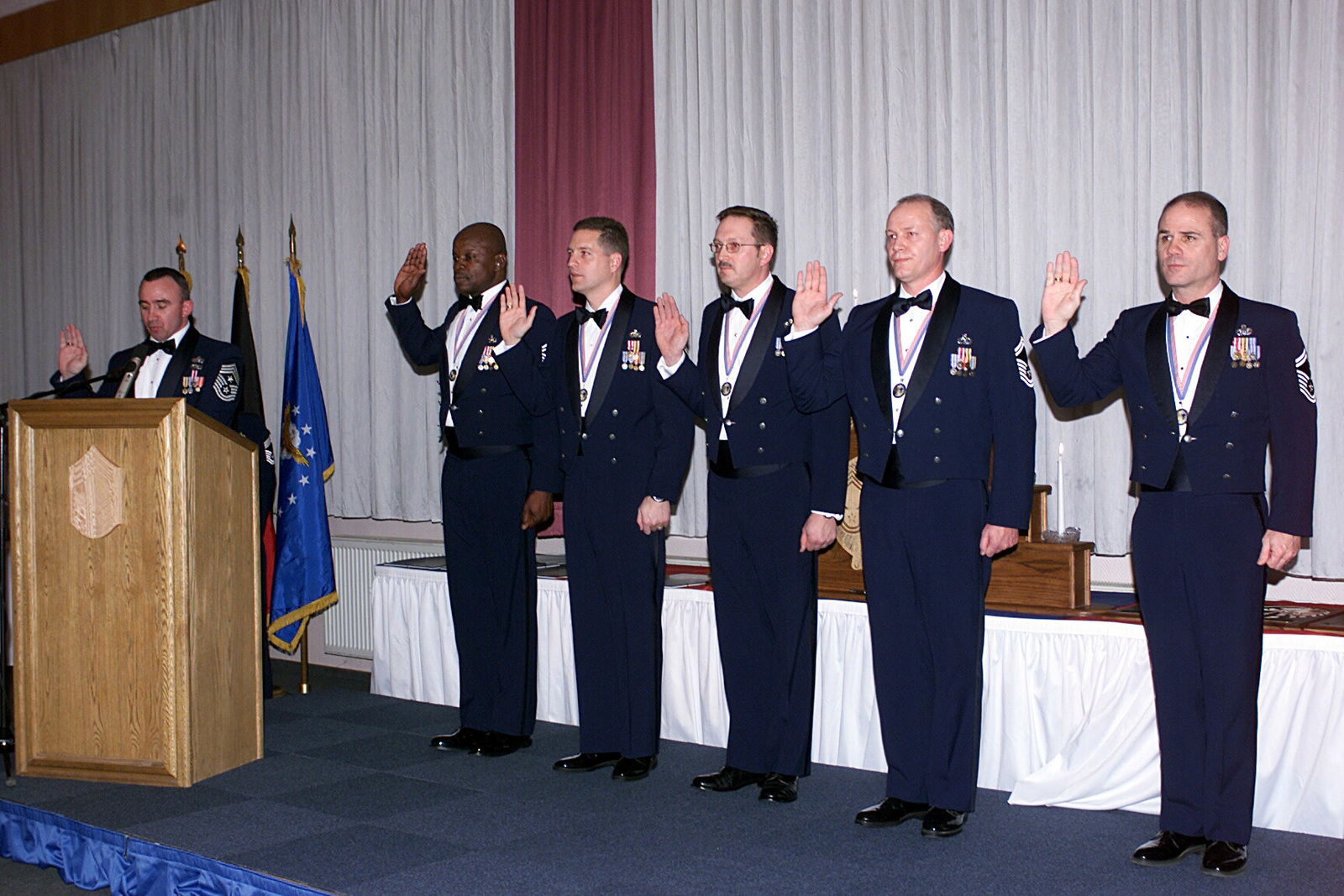 US Air Force (USAF) Command CHIEF MASTER Sergeant (CCMSGT) Kenneth J. McQuiston (left), 52nd Fighter Wing (FW), Spangdahlem Air Base (AB), Germany, recites the CHIEF's Creed to five USAF CHIEF MASTER Sergeant (CMSGT) selectees during the CHIEF MASTER Sergeant Induction ceremony. The new CMSGTs are from left to right: S) Mike Dortch, NATO AWACS, E-3A Component, Training Wing, Geilenkirchen AB, Germany, S) Todd W. Barnes, 52nd Civil Engineer Squadron (CES), Spangdahlem AB, Germany, S) Roger A. Schwenneker, 52nd Aircraft Maintenance Squadron (AMS), Spangdahlem AB, Germany, S) Edwin A. Blake, 52nd Component Maintenance Squadron (CMS), Spangdahlem AB, Germany, and...