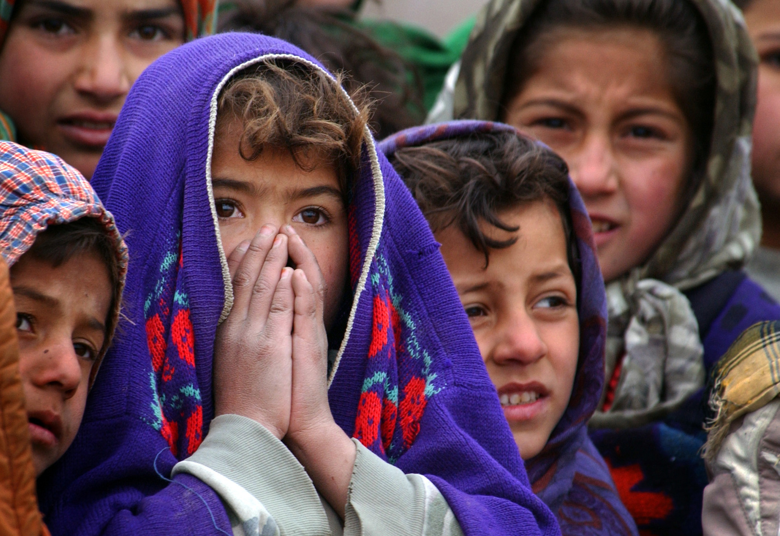 Afghani children from the village of Aroki, Province of Kapisa, in Afghanistan, wait to be seen by US military medics from the 48th Combat Support Hospital, who are conducting a Medical Civilian Action Program (MEDCAP), in support of Operation ENDURING FREEDOM