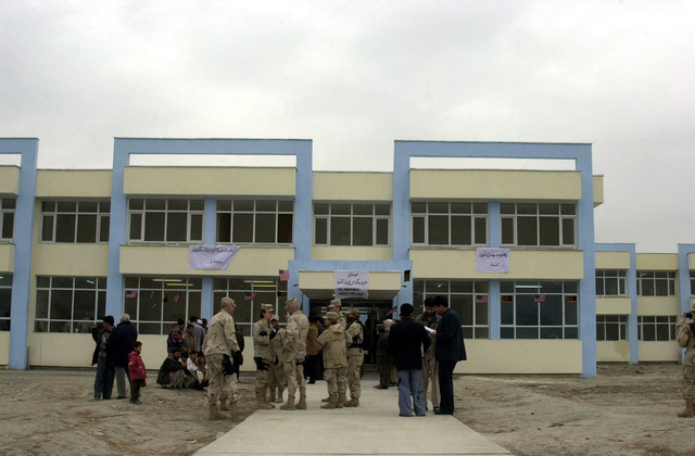 Spectators wait in anticipation of the opening ceremony for the Afghan Veterinary Complex reestablished by the Coalition Joint Civil-Military Operations Task Force and the Ministry of Agriculture, during Operation ENDURING FREEDOM 2003