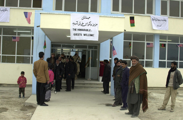 Spectators wait in anticipation of the opening ceremony for the Afghan Veterinary Complex reestablished by the Coalition Joint Civil-Military Operations Task Force and the Ministry of Agriculture, during Operation ENDURING FREEDOM