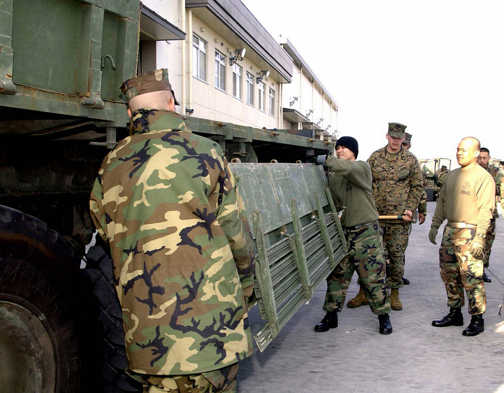 US Marine Corps (USMC) personnel assigned to Marine Wing Support Squadron 171 (MWSS-171), prepare to load equipment on vehicles during a Mobility Exercise, (MOBEX), at Marine Corps Air Station (MCAS) Iwakuni, Japan