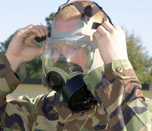 US Air Force (USAF) AIRMAN First Class (A1C) Charles Wortham, 81st Transportation Squadron (TRS), makes an adjustment to his MCU-2P gas mask during a chemical warfare exercise conducted at Kessler Air Force Base (AFB), Mississippi (MS)