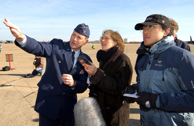 USAF Colonel (COL) Robert Murphy (left), Commander, 183rd Fighter Wing (FW), Illinois Air National Guard (ILANG), briefs members of the press on the aspects of a fighter aircraft on the flightline at Barksdale Air Force Base (AFB), Louisiana (LA). The press is covering an Article 32 investigation concerning the Tarnak Farms Friendly Fire incident that killed four Canadian soldiers and injured eight near Kandahar, Afghanistan. The Article 32 hearing is an investigation of the charges against the pilots to determine whether to try by court-martial