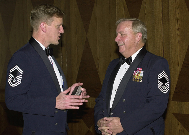 """US Air Force (USAF) CHIEF MASTER Sergeant (CMSGT) Inductee, SENIOR MASTER Sergeant (SMSGT) Thomas G. Houdek (right), Superintendent of Operations European Command, visits with the guest speaker, ninth USAF CHIEF MASTER Sergeant of the Air Force (CMSAF) James C. Binnicker, during the 2003 Ramstein Air Base (AB) CHIEF's Induction Ceremony. The induction ceremony is a special night of celebration for the 37 US Air Forces in Europe (USAFE) inductees and allows the military community an opportunity to say """"Thank You"""" to the spouses and other guests who have played a significant role in the career of our newest chiefs"""