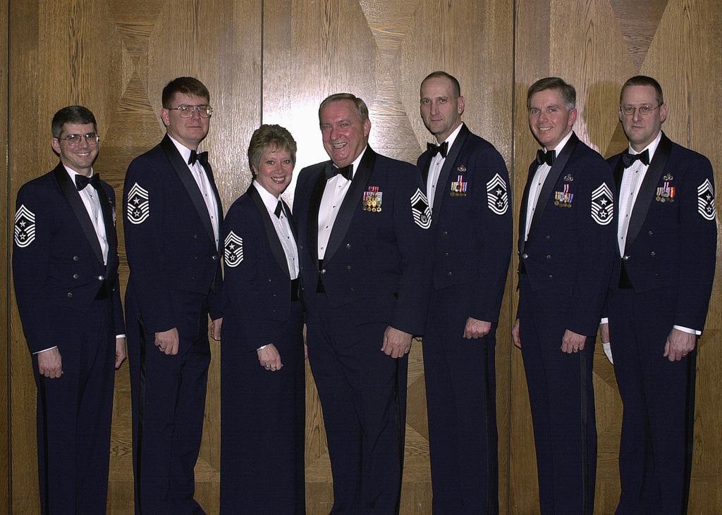 US Air Force (USAF) Command CHIEF MASTER Sergeants (CCMSGT) (from left) Tim Carroll, 86th Airlift Wing, Ramstein Air Base (AB), Germany, E. J. Griffis, 3rd Air Force, RAF Mildenhall, England, Vickie C. Mauldin, USAFE, Ramstein AB, Germany, special guest speaker ninth CHIEF MASTER Sergeant of the Air Force (CMSAF) James C. Binnicker, Doug Hodge, 65th AB Wing, Lajes Field, Azores, Patrick Masters, 26th Intelligence Operations Group, Ramstein AB, Germany, and Dan Kuester, 85th Group, Keflavik, Iceland, gather for the 2003 Ramstein Air Base CHIEF's Induction Ceremony. The induction ceremony is a special night of celebration for the 37 US Air Forces in Europe (USAFE) inductees and allows the...