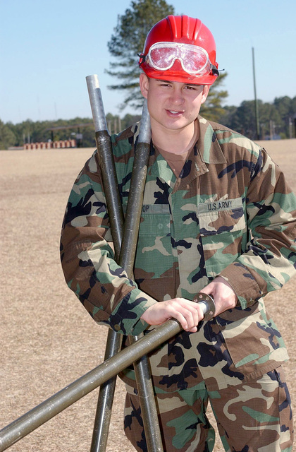 US Army (USA) Private (PVT) Geofrey Kop from Bravo Company, 369th Signal Battalion, a student at the 31C Military Occupational Specialty Course, disassembles an AB155 antenna