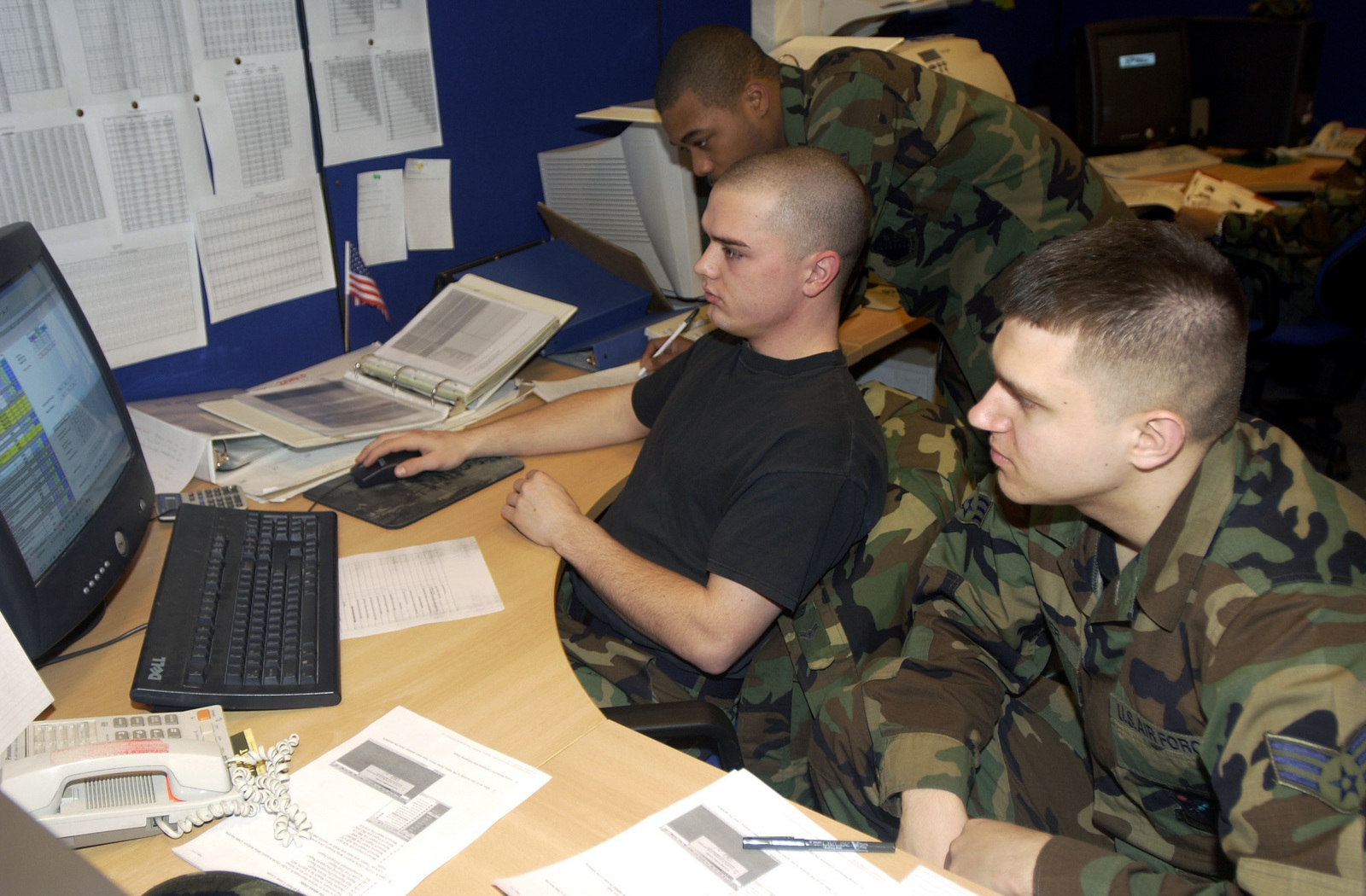 US Air Force (USAF) members of the 31st Maintenance Operations Squadron (MOS), work to compute annual spare aircraft requirements to predict the availability of the aircraft for the fiscal year 2004