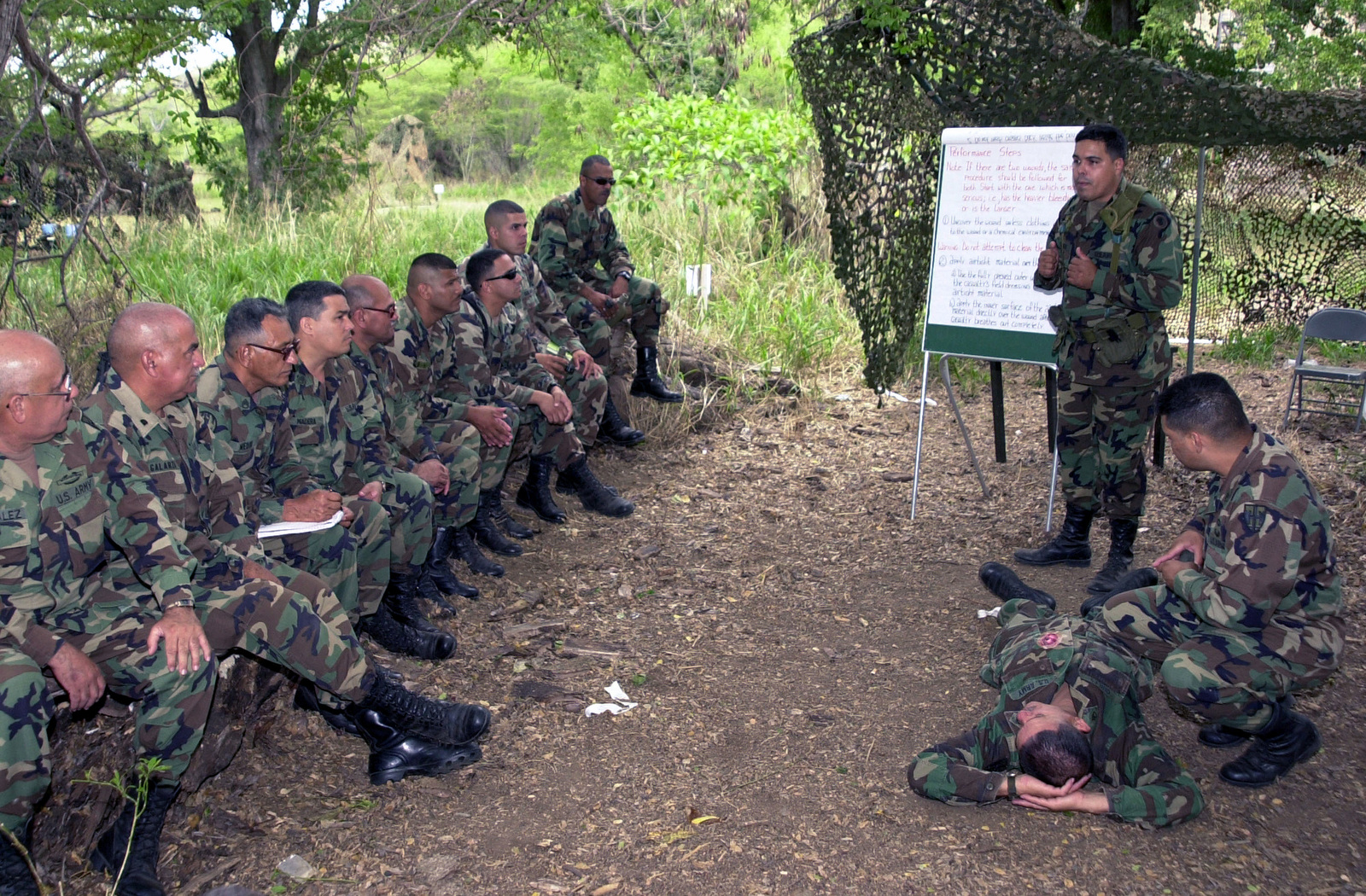 US Army (USA) Sergeant First Class (SFC) Ivan Torres (standing right), Observer/Controller from the 2nd Battalion, 348th Infantry Regiment, 174th Infantry Brigade, 87th Division, conduct a first aid training course with Puerto Rico National Guard Soldiers, from the 755th Military Police (MP) Company, 125th MP Battalion, 101st Troop Command, while conducting Common Task Training (CTT), at the Camp Santiago Training Site (CSTS), located in Salinas, Puerto Rico (PR)