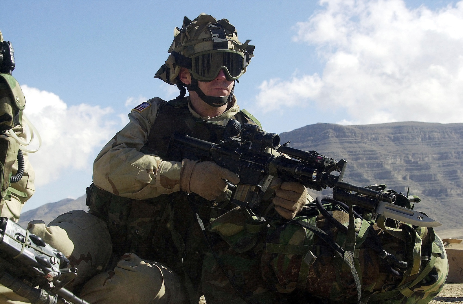 """Armed with 5.56mm M4 Carbines, First Sergeant (1SG) Jimmy Carabello of """"A"""" Company, 2nd Battalion, 504th Parachute Infantry Regiment (PIR), stands alert at the Kandahar Army Airfield, during a search for Taliban fighters in support of ENDURING FREEDOM"""