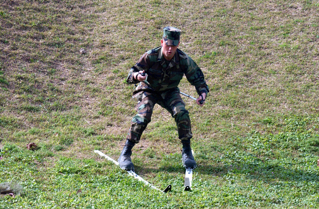 Corporal (CPL) Chris Wanet, a rifleman with 2nd Battalion, 3rd Marines, while a little shaky, manages to successfully slide down a small grass hill during a class on proper skiing techniques
