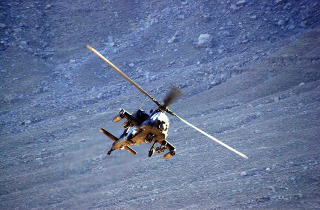During Operation Mongoose, a US Army (USA) AH64A Apache attack helicopter is called in to destroy a large cave suspected storing a Taliban weapons cache, during Operation ENDURING FREEDOM