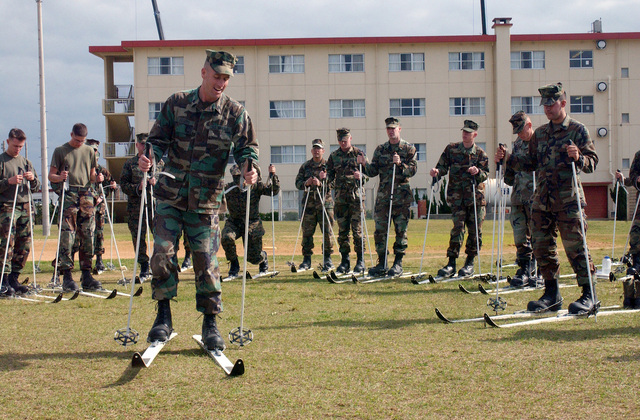 Sergeant (SGT) Keith Eggers, a rifleman from 2nd Battalion, 3rd Marines, stands before his Marines demonstrating proper skiing techniques during a class in preparation for their cold weather deployment to northern Japan for a 3week exercise