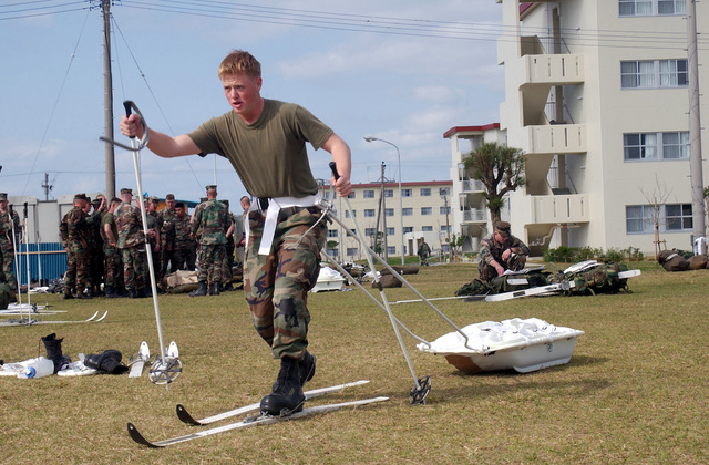 US Marine Corps (USMC) Corporal (CPL) John Chancey, a rifleman with the 2nd Battalion, 3rd Marines, practices pulling a snow sled on skis