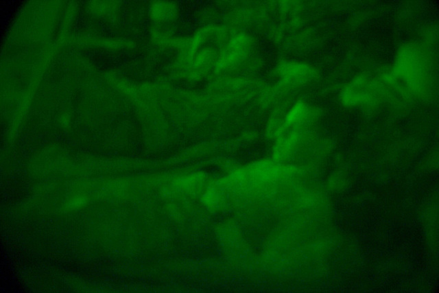 A Night Vision view of 7th Marine Regiment, Camp Pendleton, California, Marines, at rest at Camp Coyote, Kuwait