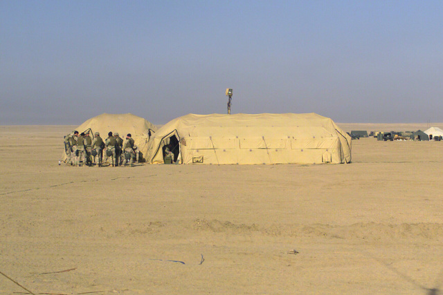 A pair of XB Series Tents houses the 7th Marine Regiment Combat Operations Center (COC) at TA Coyote during Operation ENDURING FREEDOM