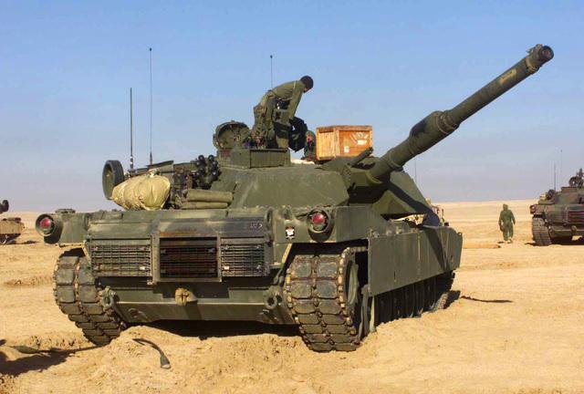 "Lance Corporal (LCPL) Richard Velasquez, USMC, Charlie Company, 1ST Tank Battalion (TK BN), 1ST Marine Division (MAR DIV), Twentynine Palms, California, restocks ""Tommy boy"" an M1A1 Abrams Main Battle Tank (MBT) at Camp Coyote, Kuwait"