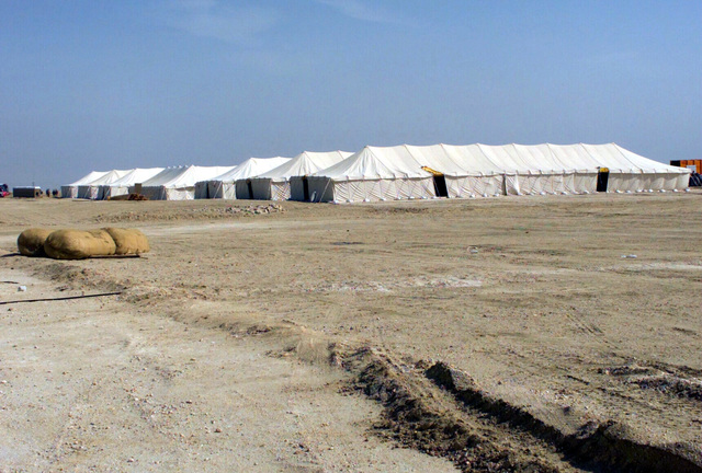 Berthing (Tent, Extendable, Modular, Personnel (TEMPER)) tents at Camp Coyote, Kuwait, during Operation ENDURING FREEDOM