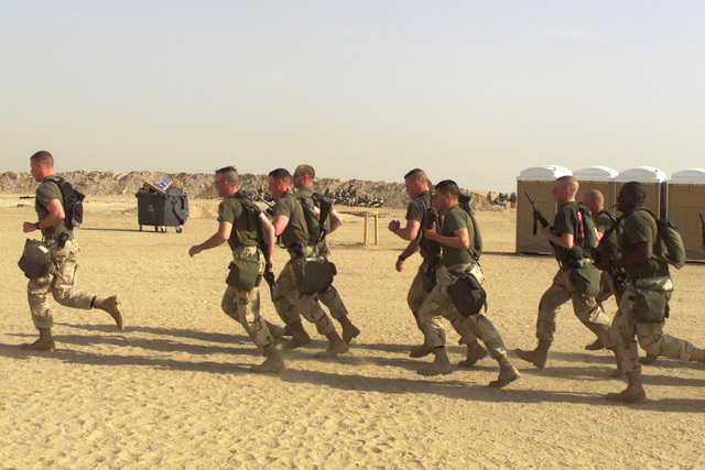 Charlie Company 1ST Combat Engineer Battalion (CEB) on a motivational formation run at Camp Coyote, Kuwait, during Operation ENDURING FREEDOM