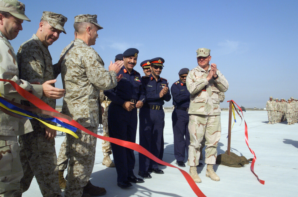 US Military and State of Kuwait Officials participate in a ribbon cutting ceremony marking the opening of the new aircraft parking ramp at Ahmed Al Jaber Air Base, Kuwait, during Operation ENDURING FREEDOM. Pictured left-to-right are: US Air Force (USAF) Brigadier General (BGEN) Roebling; US Marine Corps (USMC) Major General (MGEN) Keith J. Stalder, Deputy Director, Plans and Policy, US Central Command; USMC MGEN James F. Amos, Director, Strategy and Plans Division, Plans, Policy, and Operations; State of Kuwait Major General (MGEN) Yousaf; State of Kuwait Sheik Rakan; State of Kuwait Colonel (COL) Yousef, and US Navy (USN) Rear Admiral (RADM) Charles R. Kubic, Commander, First Naval...