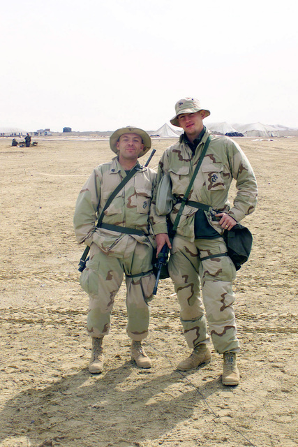 A pair of US Marines from the 2nd Battalion, 5th Marine Regiment, 1ST Marine Division, from Camp Pendleton, California, pose for a picture at Camp Coyote in northern Kuwait, during Operation ENDURING FREEDOM