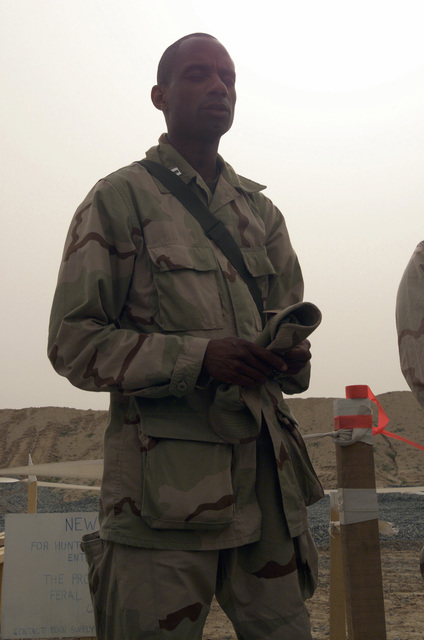 US Navy (USN) Chaplain, Lieutenant (LT) Darrell Wesley, blesses the Marine Wing Support Squadron (MWSS) 373rd training area at Al Jaber Air Base, Kuwait, in support of Operation ENDURING FREEDOM