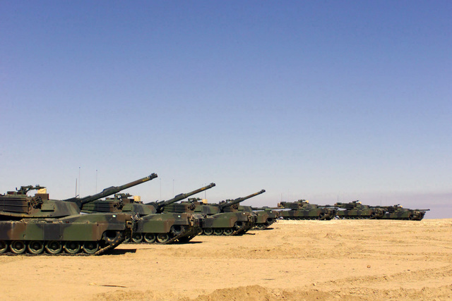 M1A2 Abrams Main Battle Tanks (MBT) with the 2nd Tank Battalion, 2nd Marine Division out of Camp Lejeune, North Carolina, in line at Camp Coyote in northern Kuwait (KWT), in support of Operation ENDURING FREEDOM