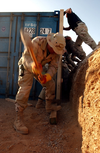 US Air Force (USAF) STAFF Sergeant (SSGT) Ken Duplechin, Equipment Operator, 320th Expeditionary Civil Engineering Squadron (ECES), aligns a support wall into place for a protective bunker built at a forward-deployed location. The bunkers are part of the continuous build up at forward-deployed locations supporting Operation ENDURING FREEDOM