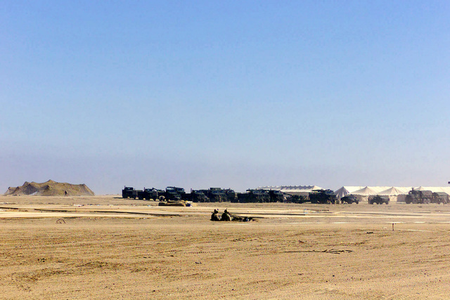 US Marine Corps (USMC) personnel assigned to 5th Marine Regiment, 1ST Marine Division, man a defensive position guarding vehicles an artillery, near the perimeter at Camp Coyote in Northern Kuwait during Operation ENDURING FREEDOM