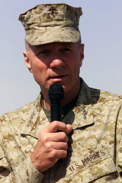 US Marine Corps (USMC) personnel from Headquarters, 5th Marine Regiment, 1ST Marine Division out of Camp Pendleton, California, listen to the Commandant of the Marine Corps (MCM) General (GEN) Michael W. Hagee, at Camp Coyote in northern Kuwait (KWT) during Operation ENDURING FREEDOM